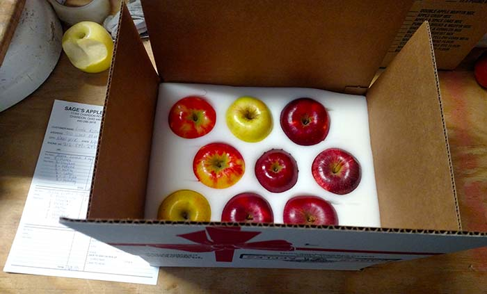 We ship each box with the varieies of apples you request along with a hand written card from you.